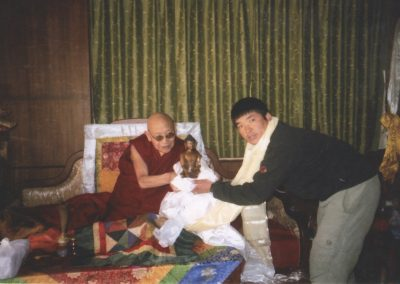 Receiving the Buddha statue from Kyabje Trulshik Rinpoche